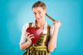 Young woman in traditional clothes dirndl or tracht bavarian with a valentines heart Royalty Free Stock Photo