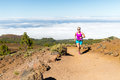 Young woman trail running in mountains Royalty Free Stock Photo