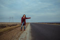 Young woman travel with hitch-hiking Royalty Free Stock Photo