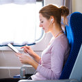 Young woman  traveling by train Royalty Free Stock Photo