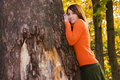 Young woman on tree Royalty Free Stock Images