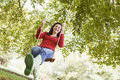 Young woman on tree swing Royalty Free Stock Photography