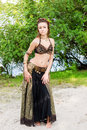 Young woman tribal american style dancer. Girl dancing and posing on the beach sand wearing belly dance costume. Ethnic Royalty Free Stock Photo
