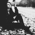 Young woman under tree black and white film style colors Stock Photo