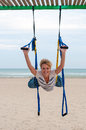 Young woman upside down doing anti gravity aerial yoga or fly yoga in hammock on sea background Royalty Free Stock Photography