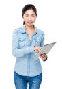 Young woman use of the tablet pc isolated on white background Stock Images