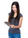 Young woman use of the tablet pc isolated on white background Royalty Free Stock Image