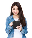 Young woman use of the tablet pc isolated on white background Royalty Free Stock Photos