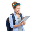 Young woman use of tablet pc for travel isolated on white background Stock Image