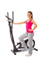 Young woman uses elliptical cross trainer Stock Photo