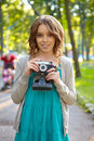 Young woman uses film photocamera Royalty Free Stock Photo