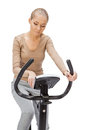 Young woman uses stationary bicycle trainer Stock Photography