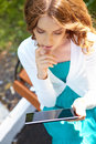 Young woman uses tablet pc Stock Photos