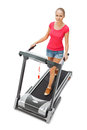 Young woman uses treadmill. Stock Images