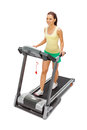 Young woman uses treadmill studio shot Royalty Free Stock Photo