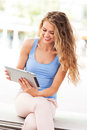 Young woman using digital tablet attractive with Royalty Free Stock Photos