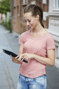 Young woman using digital tablet outdoor Stock Photography
