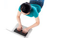 Young woman using her laptop top view lying with a working on the floor Stock Photos