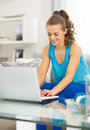 Young woman using laptop in living room modern Royalty Free Stock Photo