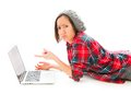 Young woman using a laptop and looking sadness adult caucasian isolated on white background Royalty Free Stock Images