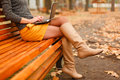 Young woman using laptop outdoor in the autumn park Royalty Free Stock Photo