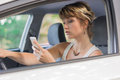 Young woman in car going on road trip.Learner driver student driving car.Driver license exam