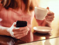 Young woman using smartphone in cafe Royalty Free Stock Photography