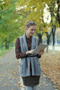 Young woman using tablet pc hipster style in autumn street Royalty Free Stock Photography