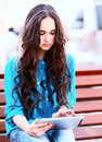 Young woman using tablet pc outdoor shoot Royalty Free Stock Photo