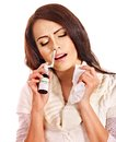 Young woman using throat spray isolated Stock Image