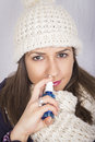 Young woman using throat spray isolated on gray Stock Photography