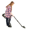 Young woman with a vacuum cleaner Stock Photography