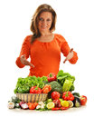 Young woman variety vegetables white background Stock Photo
