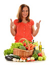 Young woman variety vegetables white background Stock Photos