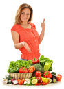 Young woman variety vegetables white background Royalty Free Stock Images
