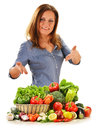 Young woman variety vegetables white background Royalty Free Stock Photography