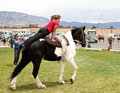 Young woman vaulter lady performs vaulting routine on horseback at the rio grande valley celtic festival in albuquerque new mexico Royalty Free Stock Photography