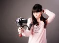 Young woman with video camera portrait of the girl as reporter a videocamera Royalty Free Stock Images