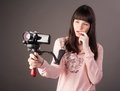 Young woman with video camera portrait of the girl of the reporter a videocamera Royalty Free Stock Photography