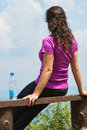 Young woman at the viewpoint pretty brunette girl sitting on bench oslusa on tara mountain Royalty Free Stock Photos