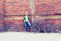Young woman with vintage road bike in city Royalty Free Stock Photo