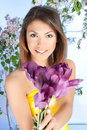 young woman with a violet tulip flower Royalty Free Stock Photo
