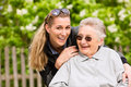 Young woman is visiting her grandmother in nursing home Royalty Free Stock Photo