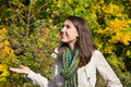 Young woman on a walk in autumn on a sunny day smiling Stock Image