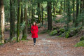 Young woman walking alone on a forest Royalty Free Stock Photo