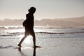 Young woman walking along beach Royalty Free Stock Photography