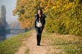Young Woman Walking In Autumn Forest Royalty Free Stock Photo