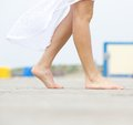Young woman walking barefoot outdoors Royalty Free Stock Photo