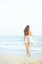Young woman walking on beach in the evening Royalty Free Stock Photo