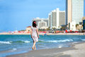 Young woman walking on the beach Royalty Free Stock Photo